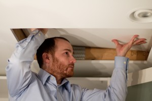 Home inspector entering an attic